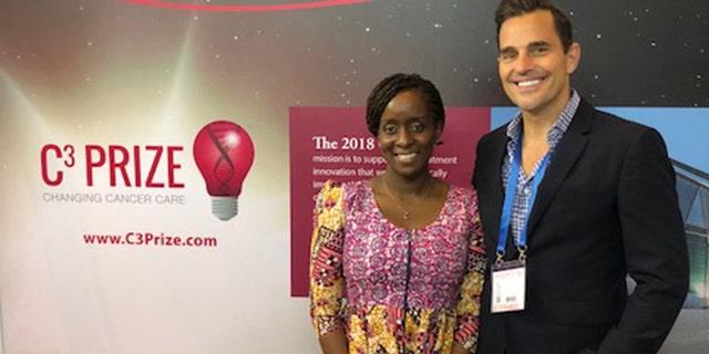 Bill Rancic with 2018 C3 Prize pitch winner, Ebele Mbanugo.
