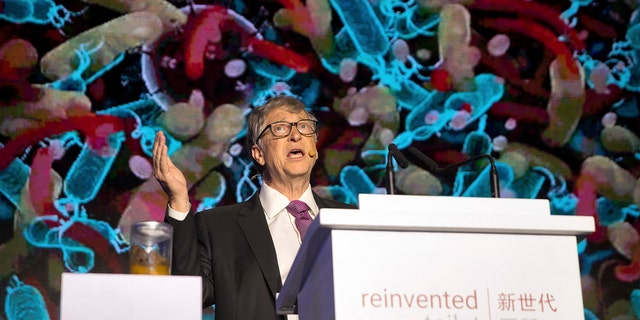 Bill Gates, former Microsoft CEO and co-founder of the Bill and Melinda Gates Foundation, speaks as a jar of human feces sits on a podium at the Reinvented Toilet Expo in Beijing, Tuesday, Nov. 6, 2018.