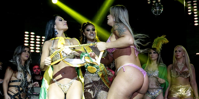 Two contestants in Brazil's Miss BumBum contest got into a fight over fake butt accusations.