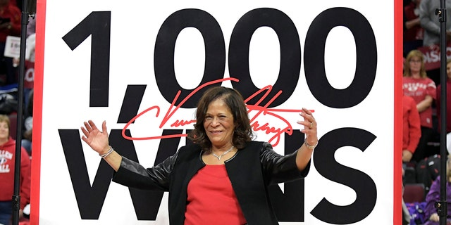 Rutgers head coach C. Vivian Stringer poses in front of a banner that will hang from the rafters after Rutgers defeated Central Connecticut for Stringer's 1,000th career NCAA college basketball game win, Tuesday, Nov. 13, 2018, in Piscataway, N.J.