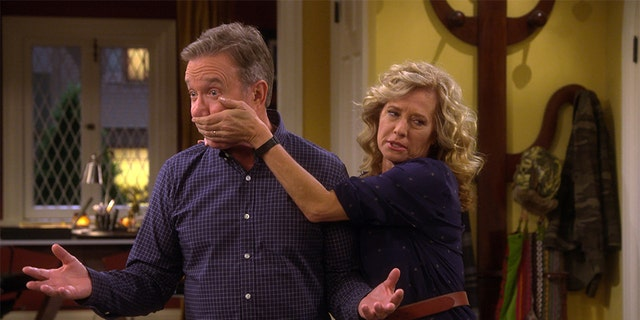 "Tim Allen and Nancy Travis filming a scene in ""Last Man Standing."""