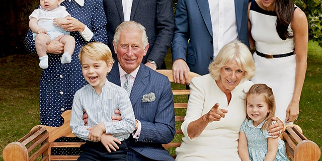 In this handout image provided by Clarence House and taken on Sept. 5, 2018, Britain's Prince Charles poses for an official portrait to mark his 70th Birthday in the gardens of Clarence House, with Camilla, Duchess of Cornwall, Prince William, Kate, Duchess of Cambridge, Prince George, Princess Charlotte, Prince Louis, Prince Harry and Meghan, Duchess of Sussex, in London, England. (Chris Jackson/Pool Photo)
