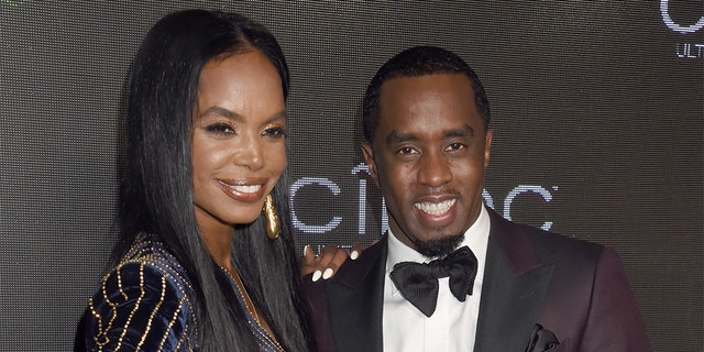 "Kim Porter and Sean ""Diddy"" Combs are pictured here in 2015. According to TMZ, the model died on Thursday. She was 47."