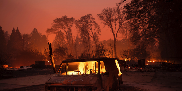 Flames burn inside a van as the Camp Fire tears through Paradise, Calif., on Thursday, Nov. 8, 2018. (AP Photo/Noah Berger, File)