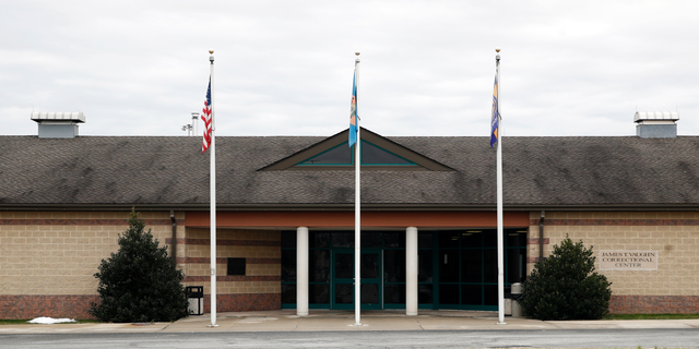 FILE - This Dec. 22, 2017, file photo shows the front entrance of the James T. Vaughn Correctional Center in Smyrna, Del. Delaware taxpayers have shelled out more than $360,000 in legal defense costs for 18 prisoners charged in a deadly prison riot last year - and the bills will continue to pile up as the trials get under way. (AP Photo/Patrick Semansky, File)
