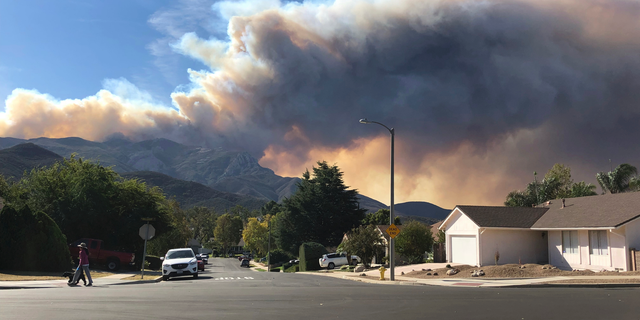 A large wildfire plume from a recent flareup near Lake Sherwood, Calif., is visible from Thousand Oaks, Calif., Tuesday, Nov. 13, 2018. (AP Photo/Amanda Myers)