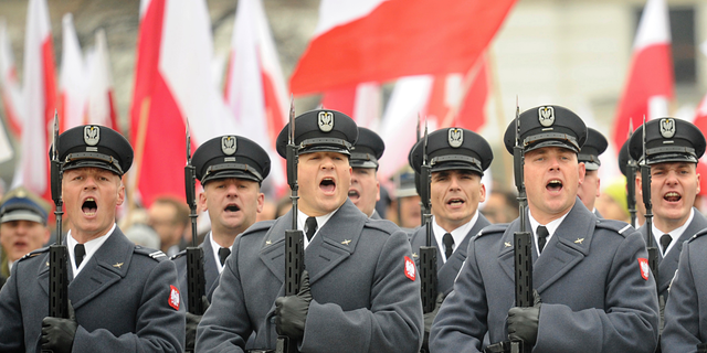 Polish Army soldiers salute during the official ceremony marking Poland's Independence Day, in Warsaw, Poland, Sunday, Nov. 11, 2018. The Independence Day in Poland celebrates the nation regaining its sovereignty at the end of World War I after being wiped off the map for more than a century. (AP Photo/Alik Keplicz)