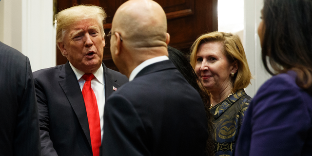 """Deputy National Security Adviser Mira Ricardel, right, watches as President Donald Trump arrives for a Diwali ceremonial lighting of the Diya in the Roosevelt Room of the White House, Tuesday, Nov. 13, 2018, in Washington. In an extraordinary move, first lady Melania Trump is publicly calling for the dismissal of Ricardel. After reports circulated that the president had decided to remove Ricardel, the first lady's spokeswoman issued a statement saying: """"It is the position of the Office of the First Lady that she no longer deserves the honor of serving in this White House."""" Ricardel is national security adviser John Bolton's deputy. (AP Photo/Evan Vucci)"""