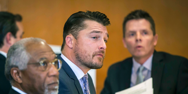 FILE - In this Nov. 27, 2017, file photo, Chris Soules, center, listens during a hearing in court in Independence, Iowa.