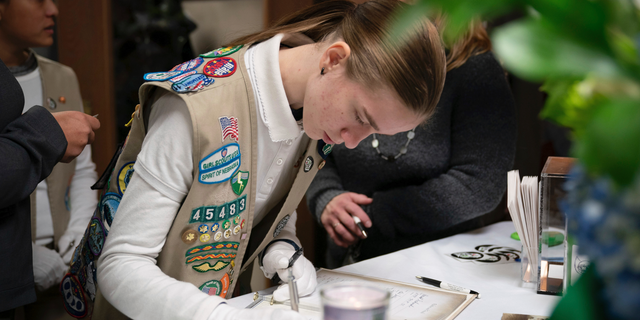 Caitlyn Talkington was part of the Spirit of Nebraska Girl Scout Honor Guard. The community of Chippewa Falls gathers as one Thursday, Nov. 8,2018, to mourn and remember three Girl Scouts and a mother who were run over and killed last weekend while picking up litter on a two-lane highway outside of town. Funerals for Sara Jo Schneider and her daughter Haylee Hickle were held on Thursday.  (Glen Stubbe/Star Tribune via AP)