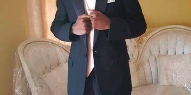 This undated image provided by Emantic Bradford, Sr. shows Emantic Fitzgerald Bradford, Jr., 21, posing for a picture at his father's home near Birmingham, Ala., in his senior year of high school. About 200 people marched through an Alabama shopping mall to protest Bradford Jr.'s death, whom police erroneously believed was the gunman who shot and wounded two people. The protesters gathered at the spot at the mall in suburban Birmingham where he was shot and killed after reports of gunfire. Police initially thought Bradford Jr. was responsible for shooting two people but later retracted that statement. (Emantic Bradford, Sr. via AP)