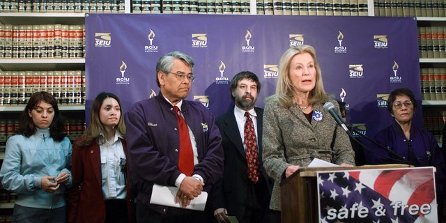 FILE - In this Jan. 17, 2002 file photo, Ramona Ripston, executive director of the American Civil Liberties Union of Southern California, at podium, announces a legal challenge to the recently enacted Aviation and Transportation Security Act, which denies qualified, lawful, permanent residents of the United States the opportunity to continue employment as screeners because they are not at the moment citizens, at the ACLU/SC in Los Angeles. Ripston, a longtime activist who built up the American Civil Liberties Union of Southern California into a major organization, has died at age 91. Ripston died Saturday, Nov. 3, 2018, at her home after several years of illness, said David Colker, a spokesman for the chapter. (AP Photo/Damian Dovarganes, File)