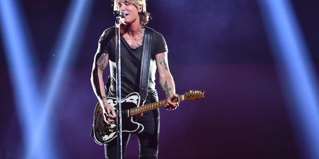"""Keith Urban performs """"Never Comin' Down"""" at the 52nd annual CMA Awards at Bridgestone Arena on Wednesday, Nov. 14, 2018, in Nashville, Tenn."""