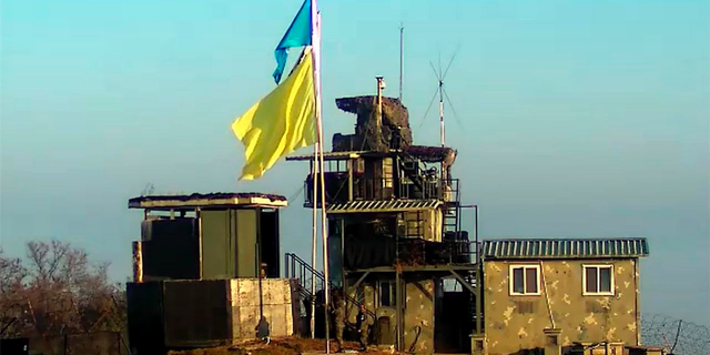 In this Nov. 4, 2018, photo provided by South Korea Defense Ministry, a yellow flag is raised at a guard post of South Korea in the demilitarized zone, South Korea. A South Korean Defense Ministry official said on Saturday, Nov. 10, 2018, the North and South Korean militaries have completed withdrawing troops and firearms from 22 front-line guard posts as they continue to implement a wide-ranging agreement reached in September to reduce tensions. The flag marks the post that is to be dismantled so that each side can observe the work in progress.(South Korea Defense Ministry via AP).