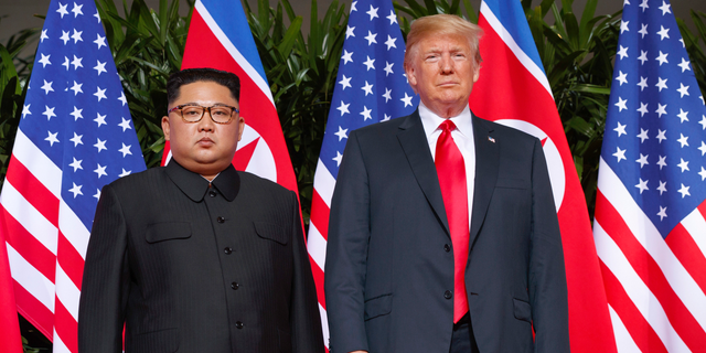 FILE - In this June 12, 2018, file photo, U.S. President Donald Trump stands with North Korean leader Kim Jong Un on Sentosa Island in Singapore. (AP Photo/Evan Vucci, File)
