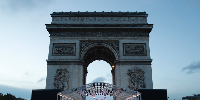 A stand is set up in front the Arc de Triomphe ahead of ceremonies marking the 100th of the end of World War I, Friday, Nov.9, 2018. About 60 leaders will mark Sunday the cease-fire that came on the 11th hour of the 11th day of the 11th month of 1918. (AP Photo/Thibault Camus)