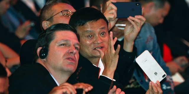 Jack Ma, Alibaba's chairman, chats after the start of Alibaba's 11.11 Global Shopping Festival held in Shanghai, China, early Sunday, Nov. 11, 2018. What started out ten years ago as a day of online promotion with US$7.8million in sales has grown into the world's biggest e-commerce event generating US$25.3billion in 2017. (AP Photo/Ng Han Guan)