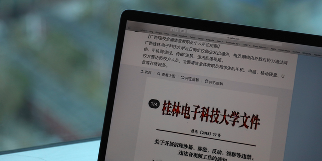 "In this photo taken Thursday, Nov. 15, 2018, a computer screen shows the leaked online post from Guilin University of Electronic Technology warning of ""hostile domestic and foreign powers"" that were ""wantonly spreading illicit and illegal videos"" through the internet in Beijing, China. (AP Photo/Ng Han Guan)"