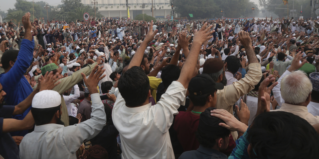 Radical Islamists rally to condemn a Supreme Court decision that acquitted Asia Bibi, a Christian woman, who spent eight years on death row accused of blasphemy, in Lahore, Pakistan, Thursday, Nov. 1, 2018. Bibi plans to leave the country, her family said Thursday, as Islamists mounted rallies demanding Bibi be publicly hanged. The Islamists also called for the killing of the three judges, including Chief Justice Mian Saqib Nisar, who acquitted Bibi. (AP Photo/K.M. Chaudary)