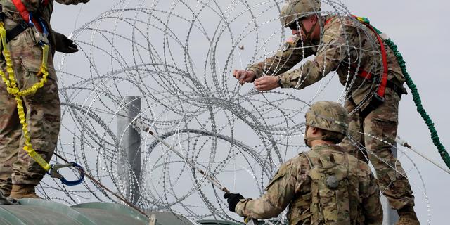 Members of the U.S.military place razor wire along the U.S.-Mexico border on the McAllen-Hidalgo International Bridge, Friday, Nov. 2, 2018, in McAllen, Texas. (AP Photo/Eric Gay)