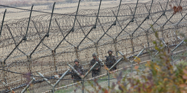 South Korean army soldiers patrol along the barbed-wire fence in Paju, South Korea, near the border with North Korea. (AP Photo/Ahn Young-joon)