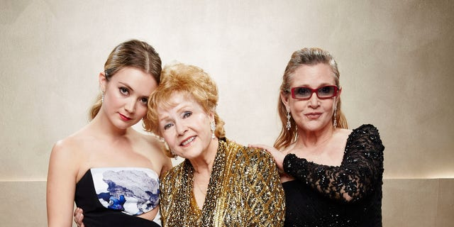 Billie Lourd, left, Carrie Fisher, center, and Debbie Reynolds pose during TNT's 21st Annual Screen Actors Guild Awards at The Shrine Auditorium on January 25, 2015 in Los Angeles, Calif. (Photo by Kevin Mazur/WireImage)