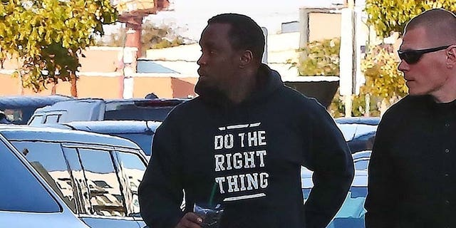 Sean 'Diddy' Combs appears completely shaken as he is seen arriving at an office building in Los Angeles a day after his ex Kim Porter's sudden death. The music mogul was seen entering a specialized movement rehabilitation center this afternoon. Kim passed away in her home yesterday. The couple have three children together.