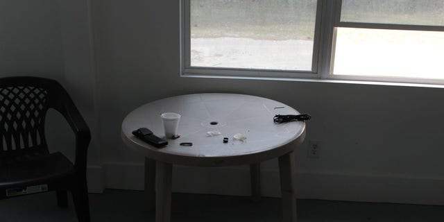 Jackson left a used Styrofoam cup on a table near an open window.