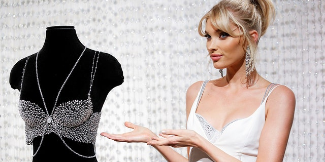 The 2018 Dream Angels Fantasy Bra and body chain are adorned with over 2,100 Swarovski Created Diamonds in a sterling silver Dream Angels bra silhouette.