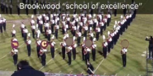 High school marching band spells out racist word during football game