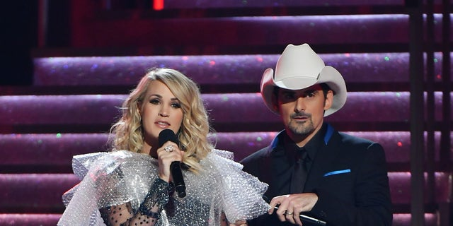 Carrie Underwood dons a bubble wrap dress as she co-hosts the 52nd annual CMA Awards with Brad Paisley at the Bridgestone Arena on November 14, 2018 in Nashville, Tennessee.