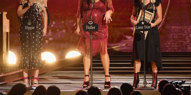 (From left) Ashley Monroe, Angaleena Presley, and Miranda Lambert of the Pistol Annies perform during the 52nd annual CMA Awards at the Bridgestone Arena in Nashville, Tennessee on November 14, 2018.