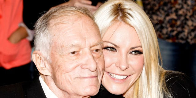 Hugh Hefner and Crystal Harris attend the Beverly Hills City Council and Playboy Enterprises ribbon-cutting ceremony for Beverly Hills Playboy World Headquarters on August 7, 2012 in Beverly Hills, Calif.