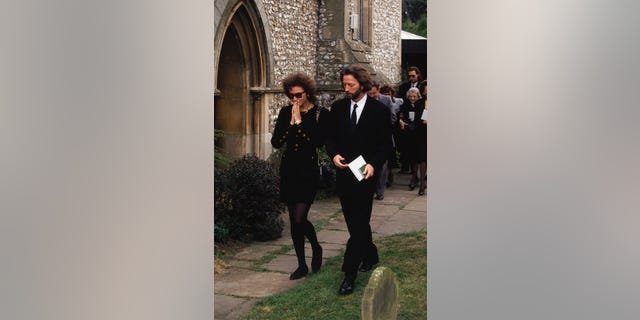 Italian actress Lori del Santo and former partner, musician Eric Clapton attend the funeral of their son, four-and-a-half-year-old Conor.