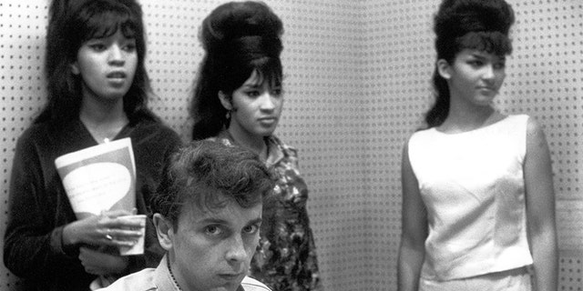 The Ronettes, a popular girl group from New York City, were signed by Phil Spector.