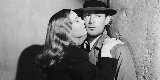 "Veronica Lake (1919 - 1973) and Alan Ladd (1913 - 1964) star in the film-noir ""This Gun For Hire,"" 1942."