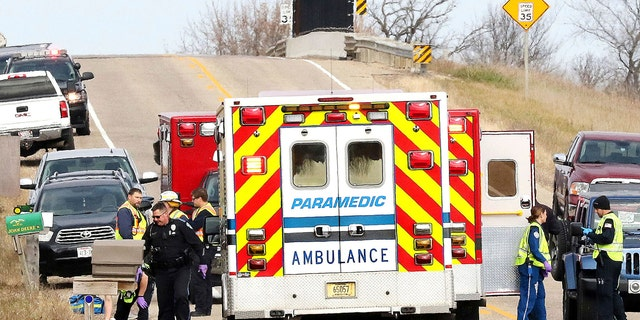 Emergency medical personnel gather at the scene of a hit-and-run accident Saturday, Nov. 3, 2018, in Lake Hallie, Wis., that killed three girls and an adult.