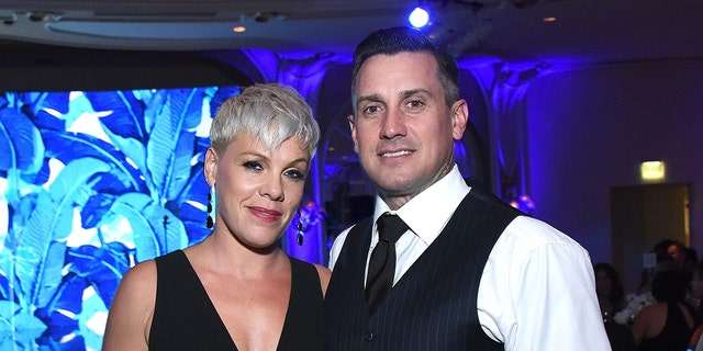 """Pink and husband Carey Hart at an Autism Speaks' """"Into The Blue"""" Gala"""