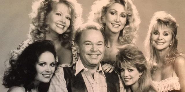 Roy Clark center; Honeys surrounding Roy, clockwise from top left: Linda Thompson, Gunilla Hutton, Irlene Mandress, Victoria Hallman, Misty Rowe.