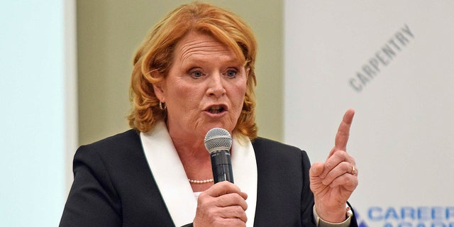 North Dakota Democratic U.S. Sen. Heidi Heitkamp makes a point in a debate with Republican Rep. Kevin Cramer.