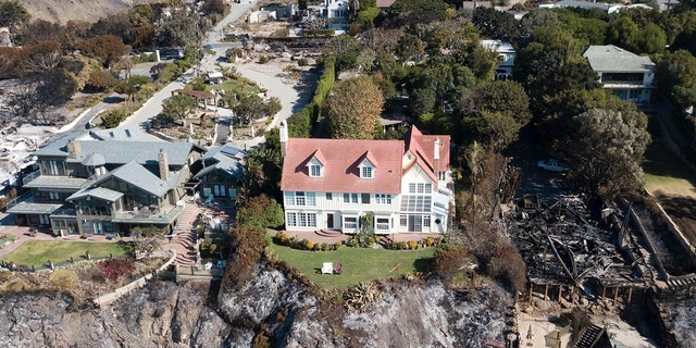 Hopkins' Malibu appeared so pristine in the midst of the wildfire, even his two deckchairs were neatly positioned in the front garden.