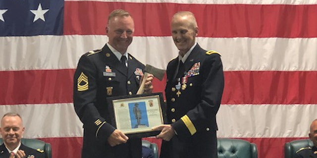 Heston (right) was one of the most decorated and highest ranking officers in Vermont's Army National Guard.