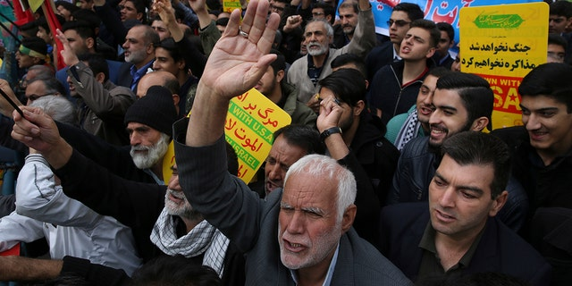Demonstrators chant slogans during an annual rally in front of the former U.S. Embassy in Tehran on Sunday to mark the 39th anniversary of the seizure of the embassy by militant Iranian students.(AP Photo/Vahid Salemi)