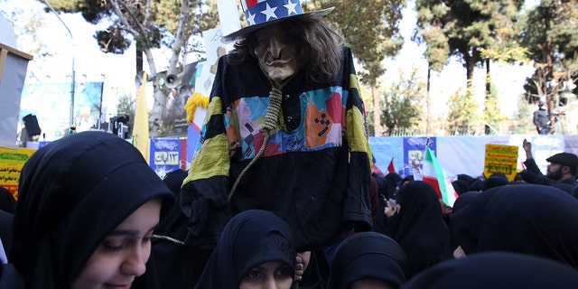 A demonstrator holds an effigy of Uncle Sam during a rally in front of the former U.S. Embassy in Tehran, Iran, on Sunday, marking the 39th anniversary of the seizure of the embassy by militant Iranian students.(AP Photo/Vahid Salemi)