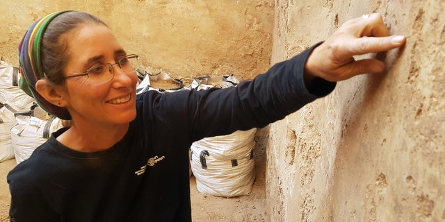 Dr. Davida Eisenberg-Degen of the Israel Antiquities Authority examines the ancient Roman cistern.
