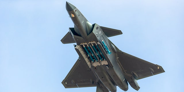 Fighter aircraft J-20 of People's Liberation Army Air Force (PLAAF) performs in the sky showing with live ammunition for the first time on day six of the Airshow China 2018 on November 11, 2018 in Zhuhai, Guangdong Province of China.