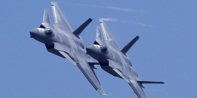 Two J-20 stealth fighter jets of the Chinese People's Liberation Army (PLA) Air Force performs during the 12th China International Aviation and Aerospace Exhibition.