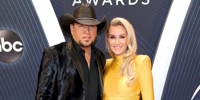 Jason Aldean and wife Brittany Kerr attend the 52nd CMA Awards in 2018.