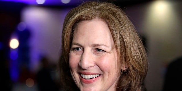 Congressional candidate Kim Schrier speaks with a reporter at an Election Night party for Democrats.