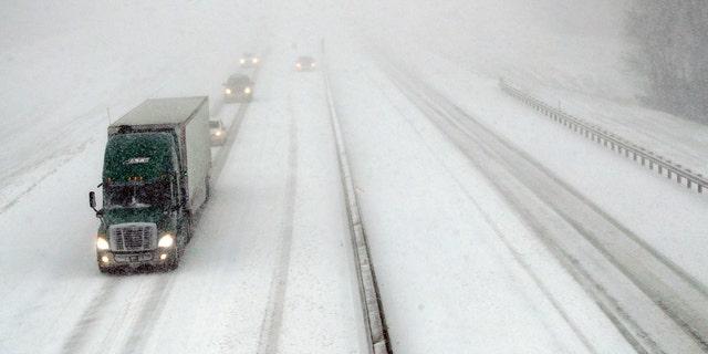 Traffic moves west along I-70 near Lawrence, Kan., Sunday. (AP Photo/Orlin Wagner)
